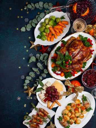 Concept of Christmas or New Year dinner with roasted chicken and various vegetables dishes. Top view. Archivio Fotografico - 111584415