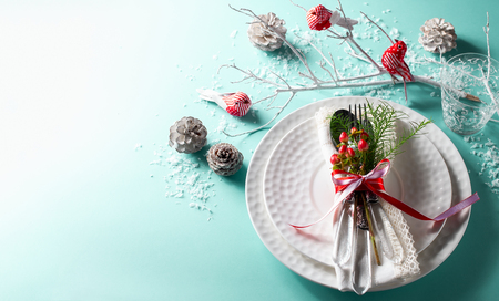 Christmas table setting for holiday dinner with natural winter decor. Top view.