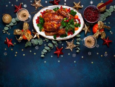 Concept of Christmas or New Year dinner with roasted chicken and various vegetables dishes. Top view. Archivio Fotografico - 111584364