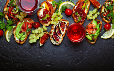 Set of assorted bruschetta  with various toppings for holiday on the stone board. Top view. Party food concept. Banque d'images - 111584340