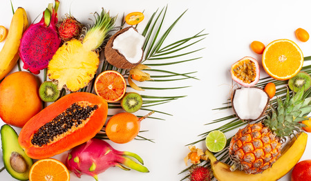 Still life with fresh assorted exotic fruits on a palm leaf. Imagens