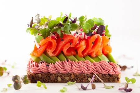 Gourmet  sandwich  with smoked salmon,avocado, beet hummus and sprouts. Concept healthy eating.  Festive appetizer.