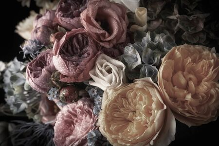 Beautiful bunch of colorful flowers on black  in vintage style. Festive flowers concept. Imagens