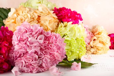 Bouquet of beautiful hydrangea on the wooden table. Colorful flowers hortensia.
