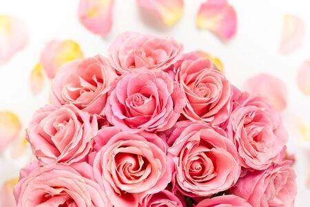 Beautiful fresh bunch of pink roses. Festive floral background. Top view with copy space.