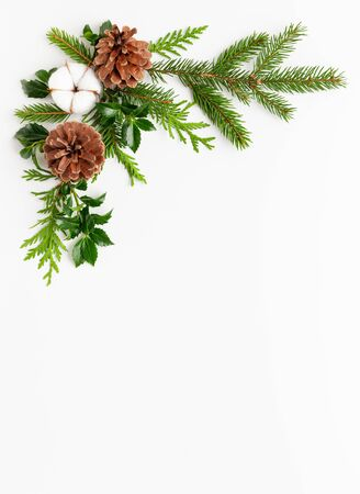 Christmas composition  with branches of spruce and holly  on white background. Merry christmas greeting card with empty space for holiday text. Flat lay Imagens