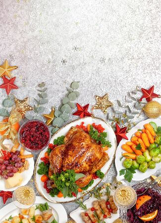 Concept of Christmas or New Year dinner with roasted chicken and various vegetables dishes. Top view. Stock fotó