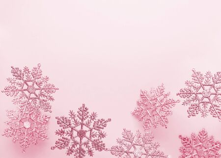 Festive winter background with decorative snowflakes in flying. Christmas, Winter or New Year concept with snowflakes. Flat lay, copy space. 写真素材