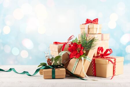 Christmas or New Year background with festive gift boxes. Holiday Christmas concept.