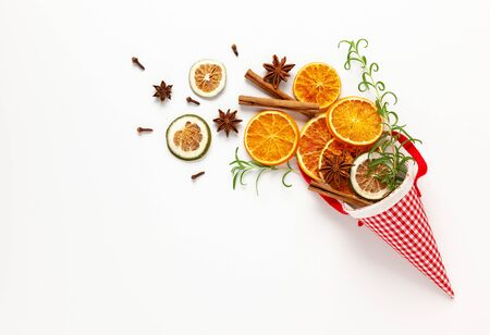 Christmas composition with dried oranges and spices on white background. Natural food ingredient for cooking or Christmas decor for home. Flat lay. 免版税图像