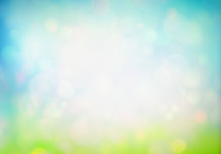 Spring or summer abstract nature background with fresh grass on blue sky backdrop with copy space. Easter concept.