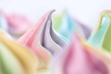 Closeup of sweet rainbow color and twisted meringue cookies. Concept of sweet food. Macro, soft focus Standard-Bild