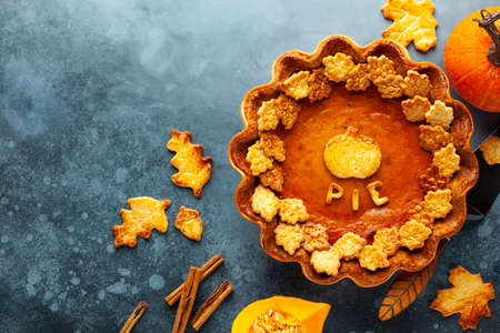 Traditional American Pumpkin Pie for Thanksgiving Day. Top view, copy space. Concept homemade baking for holiday. 写真素材
