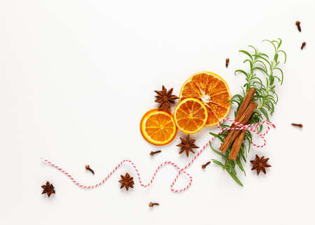 Christmas composition with dried oranges and spices on white background. Natural food ingredient for cooking or Christmas decor for home. Flat lay, copy space. 免版税图像