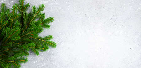 Christmas or New Year background with green fir branches. Winter concept, top view, copy space