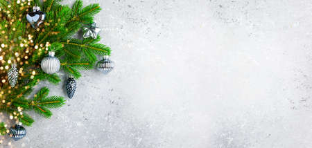 Christmas or New Year background with green fir branches and Christmas ornaments. Winter holiday concept, top view, copy space 免版税图像