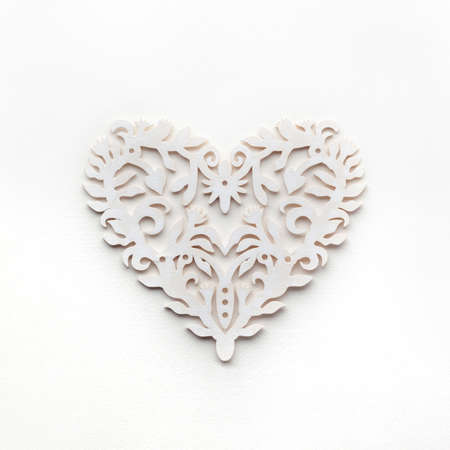 White openwork heart on white