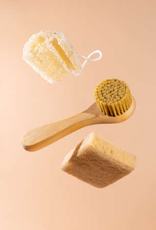 Set of eco friendly natural cleaning products.Natural wood brush, sponge made from agave and luffa sponge. Zero waste, natural home product and eco clean concept.