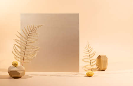 Gold Paper sheet, wooden stones and dried leaves