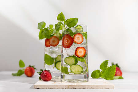 Summer detox drink. Strawberry, mint and cucumber refreshing water.