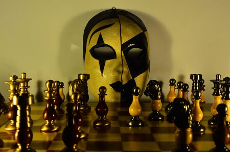 esoterism: Venetian mask and checkerboard Stock Photo