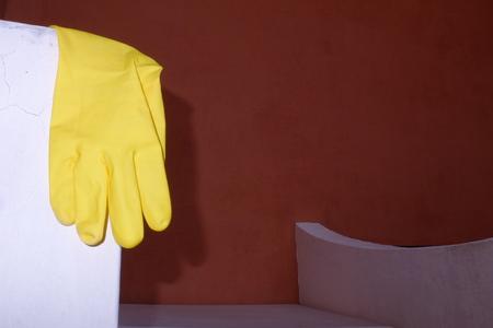 metaphysics: glove yellow Stock Photo