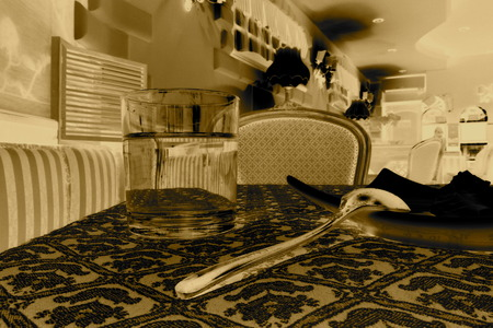 metaphysical: Inside of a bar, fork and glass Stock Photo