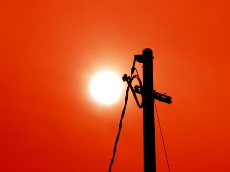 setting  sun: Light pole and setting sun