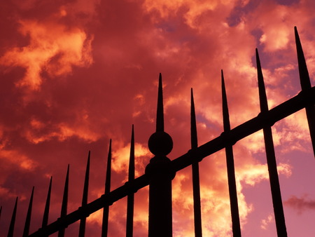 cloudburst: Gate and red stormy sky, Villa Borghese, Rome Stock Photo
