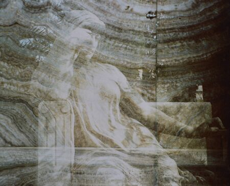 metaphysics: Statue in a cemetery with overlay of venatore of a marble lastar u