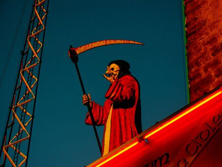 scythe: Death with a scythe, funfair Stock Photo