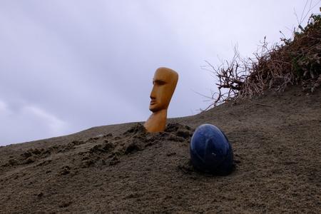 metaphysics: Totem statue on a sand dune