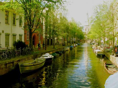 along: Amsterdam, boats along the canal