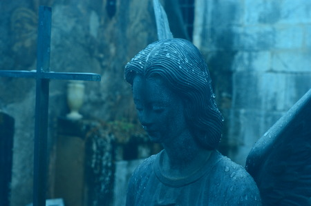 melancholia: Angel in a cemetery in the rain