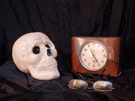 skull and old clock Stock Photo
