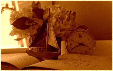 Model of a boat on a book Archivio Fotografico - 98096060