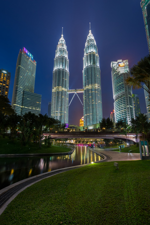 KUALA LUMPUR, MALAYSIA JULY 15: Night view of Petronas Twin Towers (fondly known as KLCC) and the surrounding buildings at during blue hour
