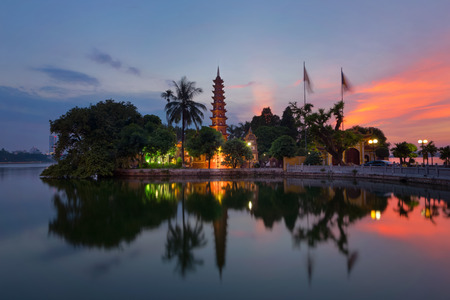 Tran Quoc Pagoda the oldest Buddhist temple in Hanoi, Vietnam. Located on a small island in West Lake with beautiful sunset