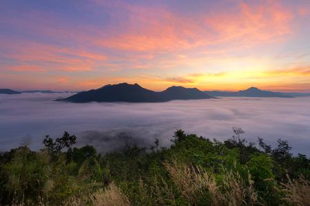 Beautiful sunrise and fog at Phu Tok Mountain at Chiang Khan, loei, Thailand. Dramatic scene. Beauty world.