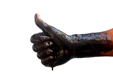 Isolated Stain hands showing thumbs up with black oil on white background (clipping path). Archivio Fotografico