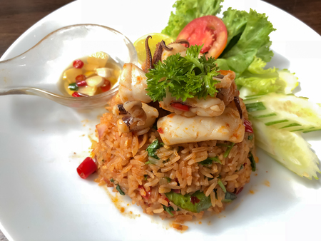Spicy fried rice with herb and seafood (tom yum fried rice),thai food concept