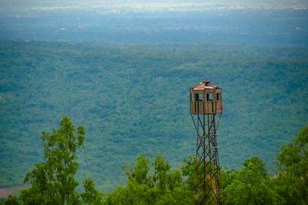 Old observation tower on the hill with nature background Stock Photo