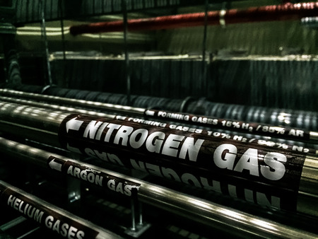 Black gas pipe line under raised floor. Fuel and energy industrial concept Standard-Bild