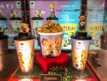 Nakhon RatchasimaThailand - Oct 14 2018:teddy house cup and Popcorn bucket set teddy house on the shelf at the cinema