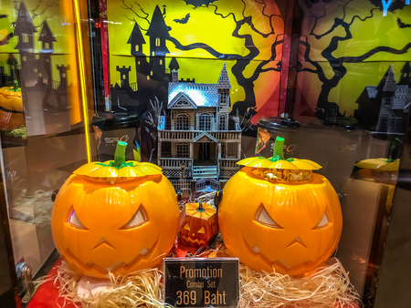 Nakhon RatchasimaThailand - Oct 04 2018:soft drink cup and pumpkin Popcorn bucket set halloween on the shelf at the cinema