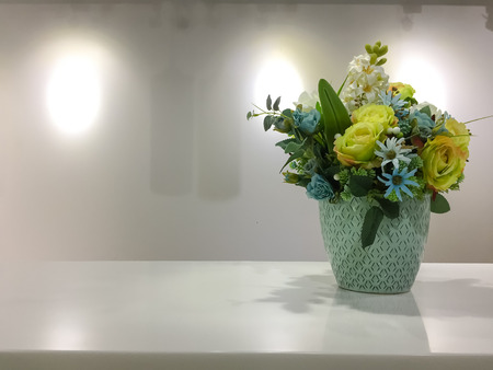 flower in vase on white table and white background