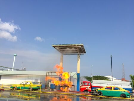 Fire at the old gas station with taxi car and blue sky background. Stock fotó - 149725949