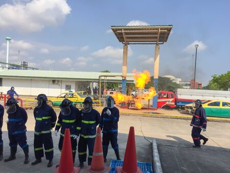 Bangkok/Thailand - April 12 2019:Fire at the old gas station with taxi car and blue sky background.