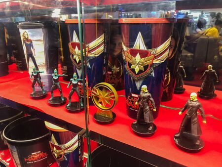 Nakhon Ratchasima/Thailand - Apr 12 2019:captain marvel tumbler cup and Popcorn bucket  marvel set on shelf at the cinema.