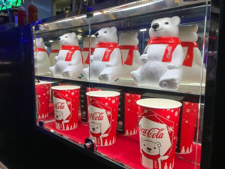 Nakhon Ratchasima/Thailand - Apr 12 2019:polar bear tumbler cup and Popcorn bucket set coke on the  shelf at the cinema.